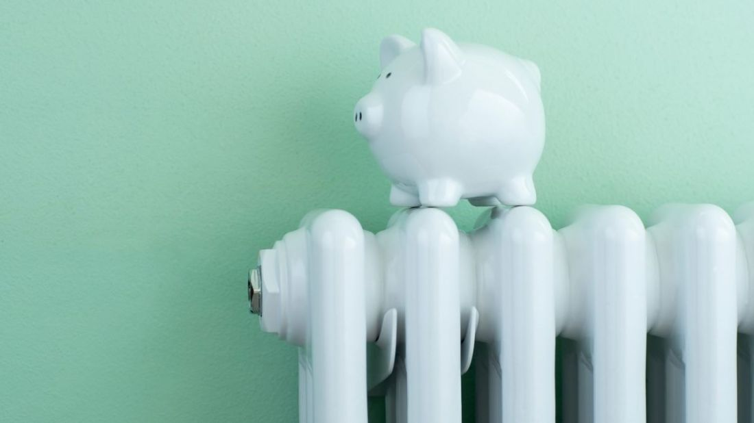A money bank on top of a radiator