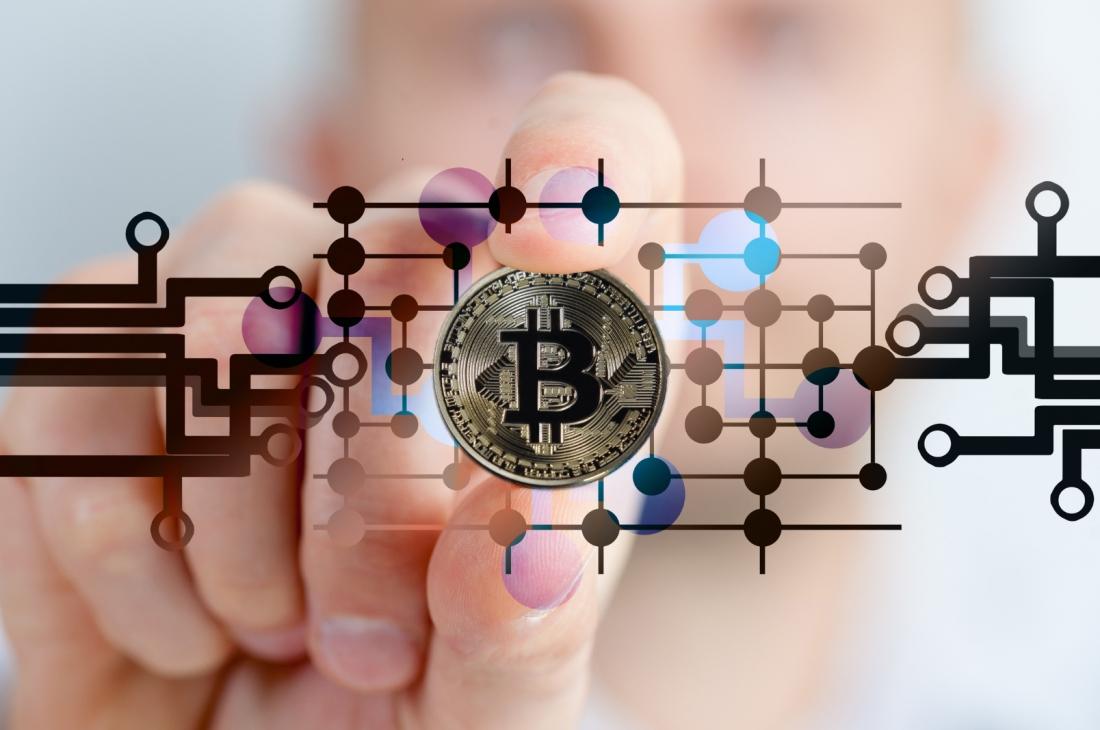An imaginary Bitcoin on a virtual microchip board